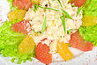 Seafood Salad Of Shrimp Baked At Cream With Orange And Grapefruit Isolated