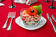 Seafood Salad With Shrimps And Fresh Vegetables, On A Serving Table. On A Red Tablecloth Close-up
