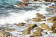 Seascape With Foaming Waves Crashing On Rocks