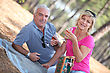 Senior Couple Enjoying Romantic Picnic stock photo