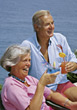 Senior Couple Enjoying Tropical Drinks stock photo