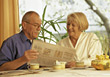 Senior Couple Having Breakfast stock photography