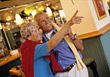 Traveling Senior Couple in Restaurant stock photography