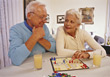 Senior Couple Playing A Boardgame stock photo