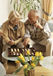 Seniors Senior Couple Playing Board Game stock photography