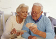 Retirement Senior Couple Playing Cards stock photo