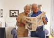 Senior Couple Reading the News stock photography