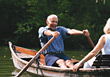 Seniors Senior Couple Rowing on Lake stock photography