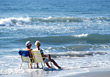 Seniors Senior Couple Sitting at the Beach stock photography