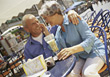 Senior Couple Sitting in Outdoor Restaurant stock photo