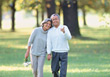 Senior Couple Walking In The Park stock photo