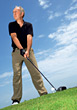 Senior Golfer About To Tee-Up stock photography