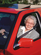 Senior Lady in a New Car stock photo