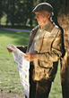 Senior Reading Newspaper in the Park stock photography