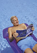 Senior Relaxing in Pool stock photography