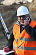 Surveying Senior Surveyor On Construction Site stock photography
