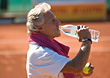 Senior Tennis Player Drinking Bottled Water stock photography