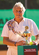 Senior Tennis Player With Trophy Cup stock photo