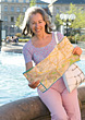 Senior Tourist With Travel Map stock photo
