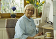 Senior Using Her Home Computer stock photo