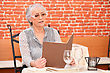 Senior Woman Reading Menu At The Restaurant stock image