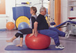 Seniors Exercising With A Swiss Ball stock photo