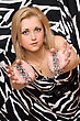 Sensual Attractive Blonde Stretches Out Her Hands In Chains stock photography