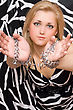 Sensual Pretty Blonde Stretches Out Her Hands In Chains stock photo