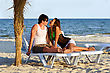 Sensual Young Couple On The Beach At Sunset