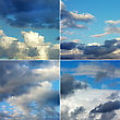 Set Of Black And White Clouds On Blue Sky stock photo