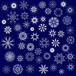 Set Of Different Winter Snowflakes Isolated On Blue Background
