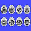 Set Of Easter Eggs With Different Ornaments Isolated On Blue Background
