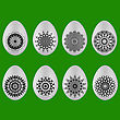 Set Of Easter Eggs With Different Ornaments Isolated On Green Background