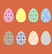 Set Of Easter Eggs With Different Ornaments Isolated On Red Background