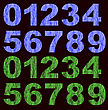 Set Of Grunge Blue Green Numbers Isolated On Black Background
