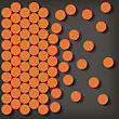 Set Of Orange Pills Isolated On Gray Background