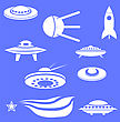 Set Of Spaceships Silhouettes Isolated On Blue Background