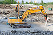 Backhoe Several Excavators On Construction Site stock photography