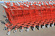 Several Shopping Carts Lined Up With Each Other stock photo