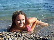 Sexual Girl Lays On A Pebble On Seacoast2