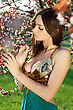 Sexy Brunette Looking At The Branches Of A Blossoming Tree stock image