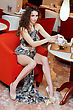 Sexy Young Woman Sitting At A Table In Restaurant