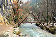 """A"" shaped wooden bridge over mountain creek"