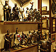 Shelf In Antiquities Shop With Metal Medieval Crusades Knight Soldiers. stock photography