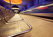 Traveling Shiny Chrome Subway Benches stock photo