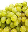 Shot Of A Bunch Of Green Grapes, Laying And Isolated On White