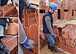 Shots Of Bricklayer At Work In Construction Site stock image