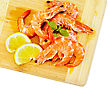 Shrimp On A Wooden Board With Slices Of Lemon And Basil Isolated On White Background stock photography