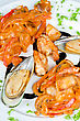 Clam Shrimps Mussels And Squid Tasty Seafood Dish stock image