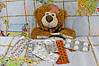 Hospital Sick Teddy And Many Medicaments In A Bed stock photo